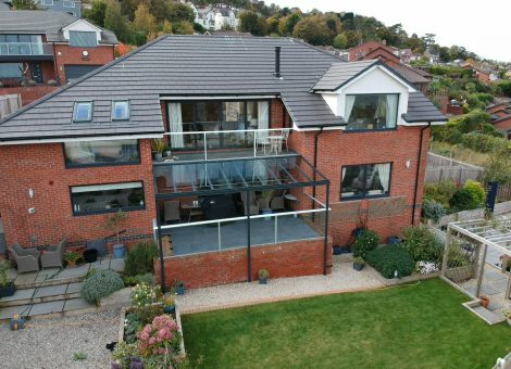 Glass veranda installed over a balcony in north wales by dencas of chester